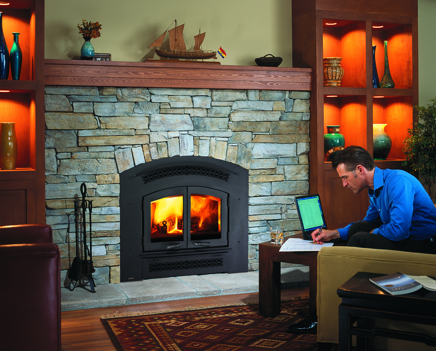 Man working in front of fire place