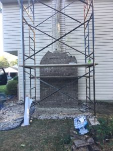 chimney being fixed wtih bricks