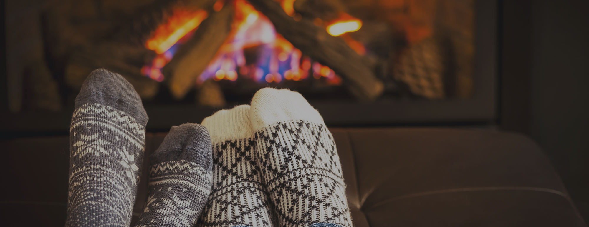 feet in front of a fire